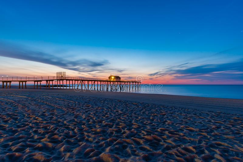 Belmar pier before sunrise, New jersey stock photography