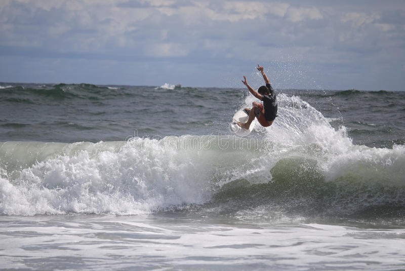 Belmar Surfer. A surfer riding a breaking wave in the Foster's Belmar Pro Surfing contest stock images