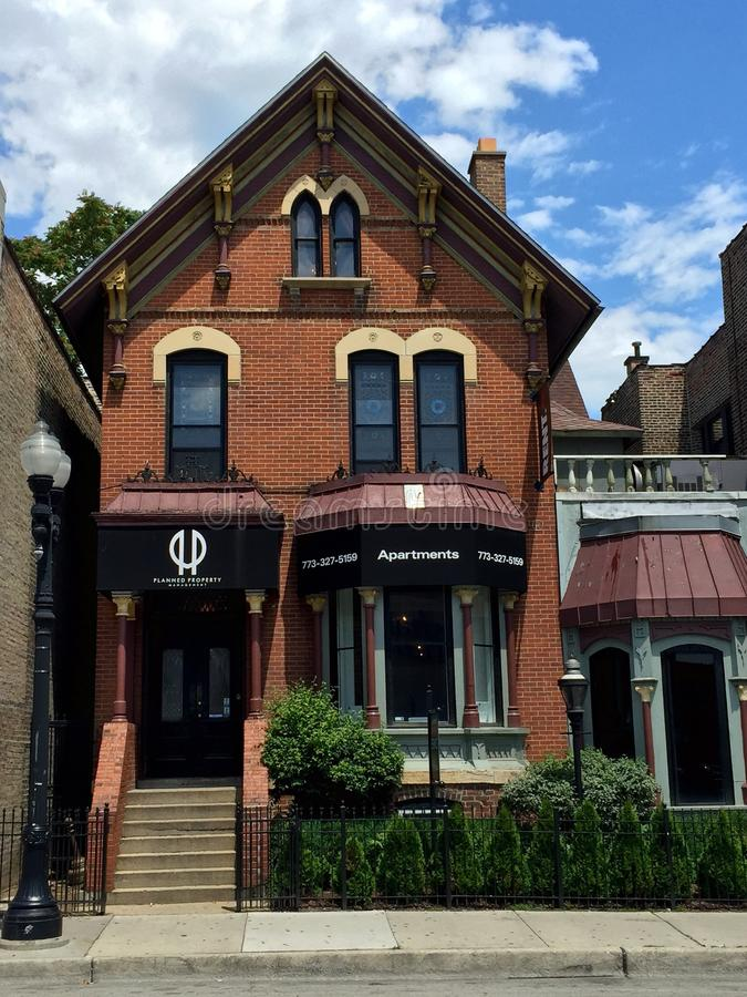 Belmont Avenue Italianate. This is a Summer picture of an iconic house converted into apartments located in the East Lakeview neighborhood of Chicago, Illinois stock images