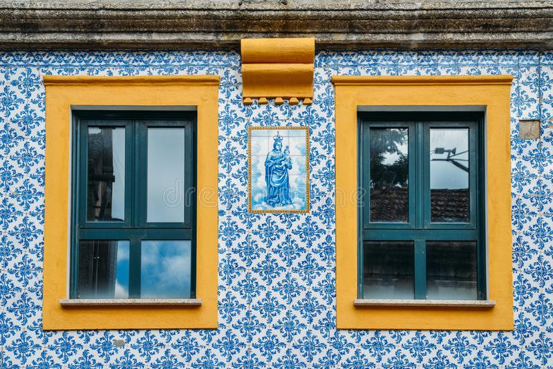 Facade of traditional building with typical Portuguese azulejo tiles. Belmonte, Portugal - June 11th, 2018: Facade of traditional building with typical stock photography