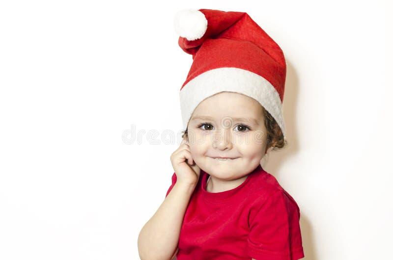 Belo bebê sorridente de vestido vermelho em masquerade, carnaval foto de stock royalty free