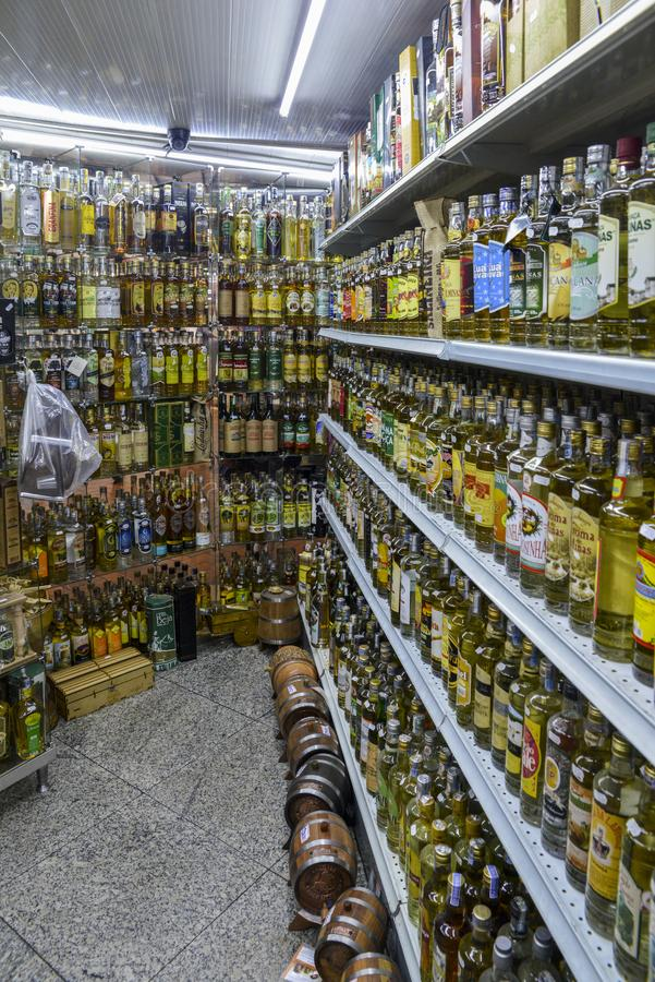 Rows of different types fo cachaca drink, made from distilled ru. Belo Horizonte, Brazil - Dec 23, 2017: Rows of different types fo cachaca drink, made from stock image