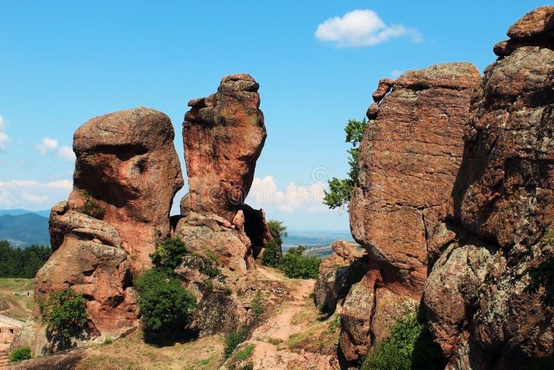Belogradchik red sandstone rock vertical pillars. In summer stock photography