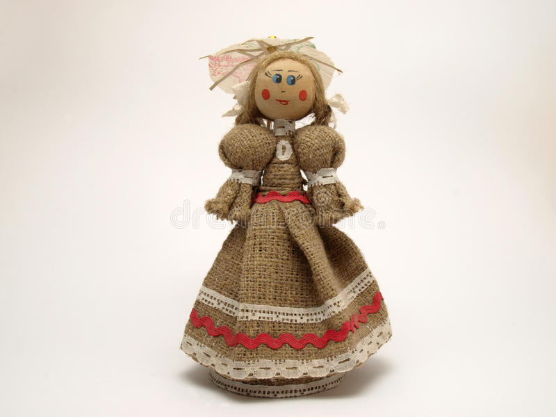 Belorussian doll. A toy doll with an umbrella fabric made stock images