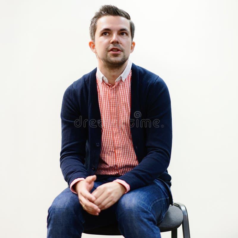 Belorussian journalist Sasha Filipenko sitting on chair royalty free stock image