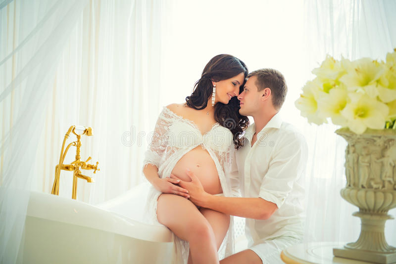 The beloved parents. Tender Kiss pregnant couples. The beloved parents. Tender Kiss pregnant couples royalty free stock photo