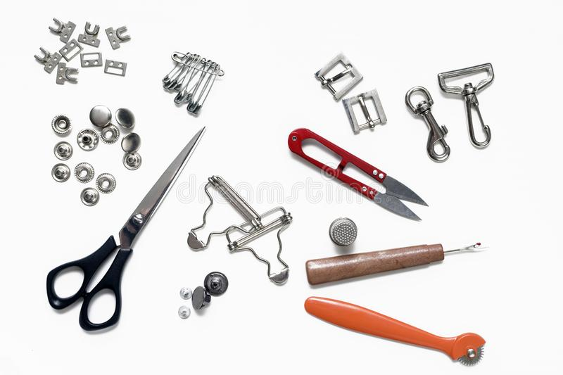 Belt buckles and rivets and metal sewing accessories stock images