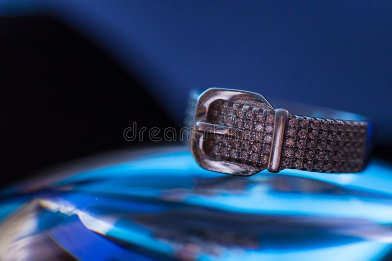 Belt clasp shape sliver ring with zircons.  stock photo