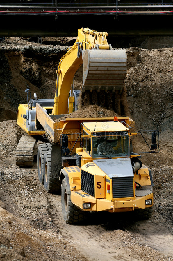 Belt excavator loading a big dumper stock photo