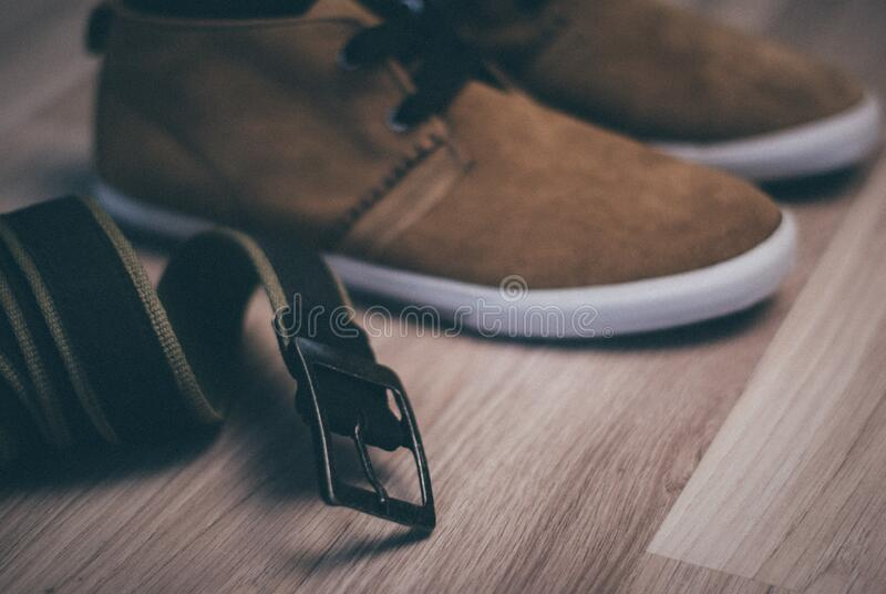 Belt and shoes stock images