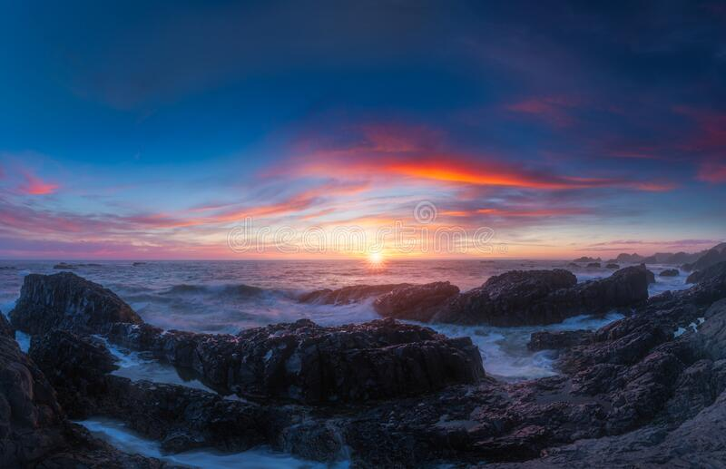 Beluga Rock sunset in super wide angle view. This is a super wide angle panorama of Beluga rock sunset stock images