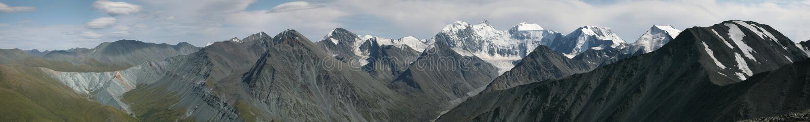 Belukha Mountain in the Altai Mountains, Russia. Belukha Mountain (4,506 m) and the Katun Range in the Altai Mountains, Russia. Panorama from Karaturek Pass (3 royalty free stock photography