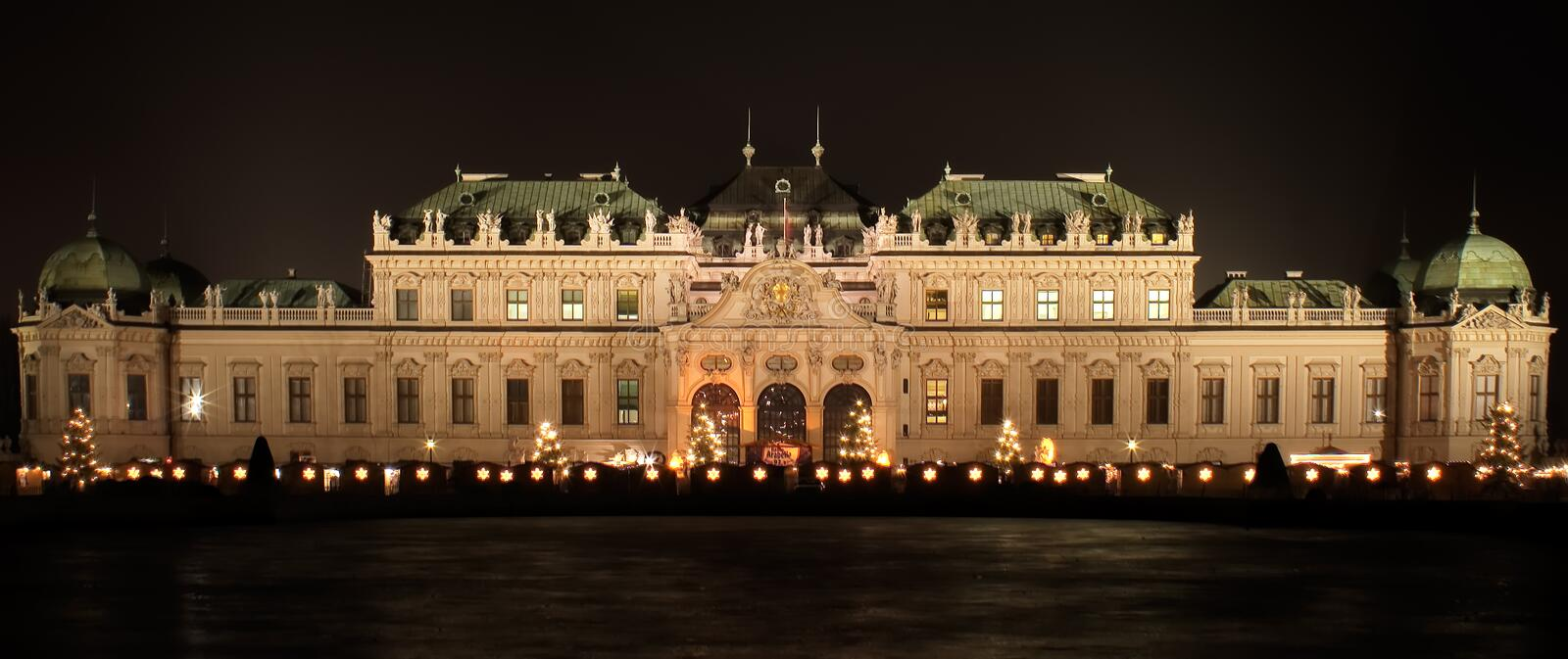 Belvedere. A nightshot of the Belvedere Palace in Vienna. In front of the palace the decorations of a Christmas Market can be seen. The photo was composed from stock photos