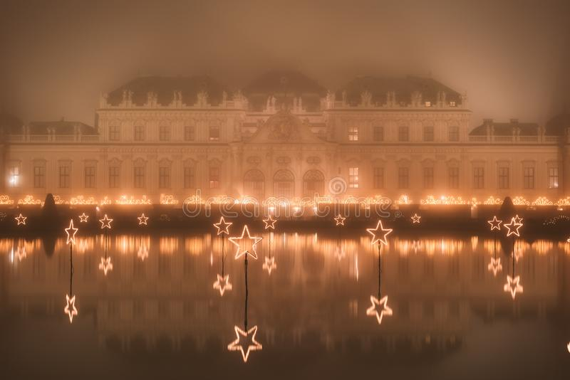 Belvedere Palace at misty night in Christmas lights royalty free stock images