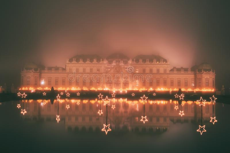 Belvedere Palace at misty night in Christmas lights stock photo