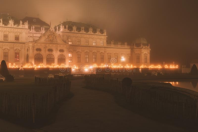 Belvedere Palace at misty night in Christmas lights royalty free stock photos
