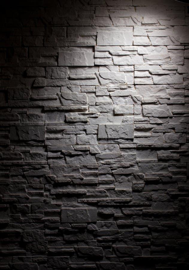 Belysningtegelstenvägg arkivfoton