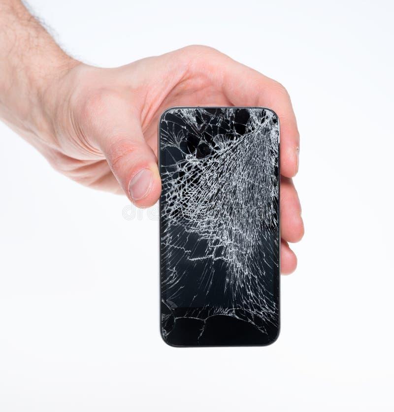 Bemannen Sie das Anhalten des gebrochenen smartphone stockbild