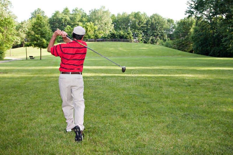 Bemannen Sie das Golf spielen stockbilder