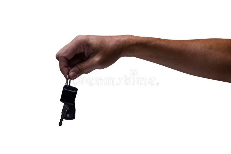 Bemannen Sie die Hand, die Autoschl?ssel lokalisiert auf wei?em Hintergrund h?lt stockbild