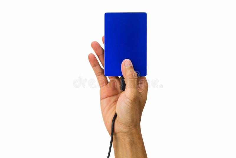 Bemannen Sie die Hand, die externe Festplatte lokalisiert auf weißem Hintergrund hält lizenzfreies stockfoto