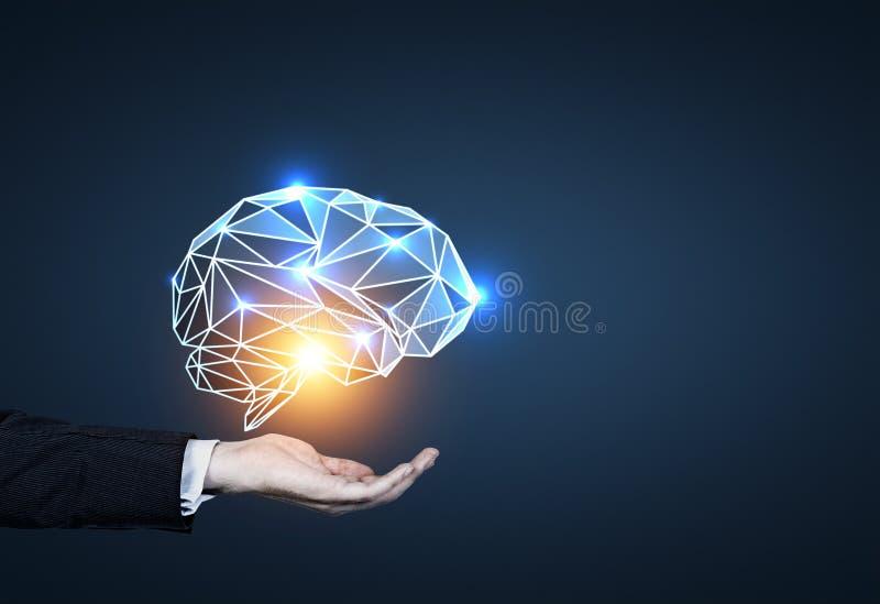 Bemannen Sie s-Hand, die das Gehirnhologramm hält, blau lizenzfreie stockfotografie