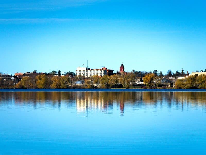 Bemidji, Minnesota reflection is seen across Lake Irving on calm sunny day stock photos