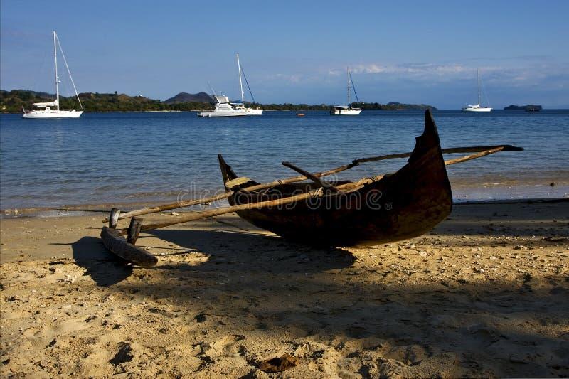 Bemoeiziek Madagascar is de boot van het de takjacht van de rotssteen stock afbeeldingen