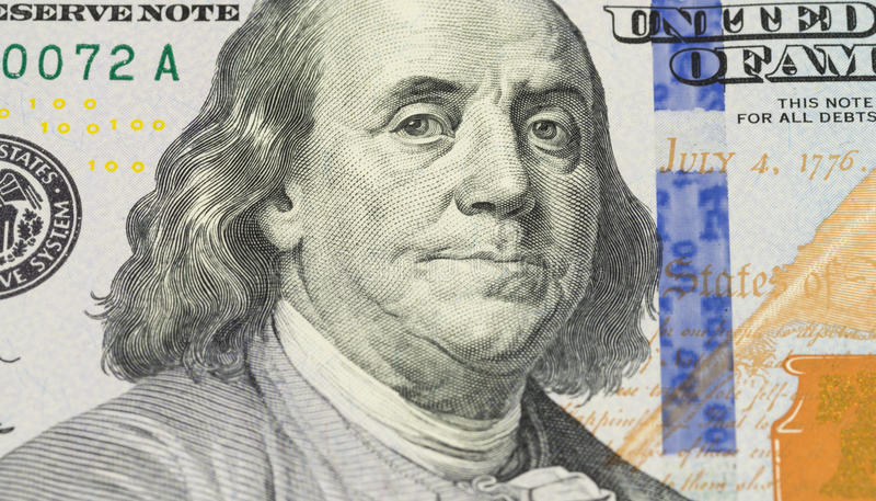 Ben Franklin face on us 100 dollar bill extreme macro, united states money closeup stock photo