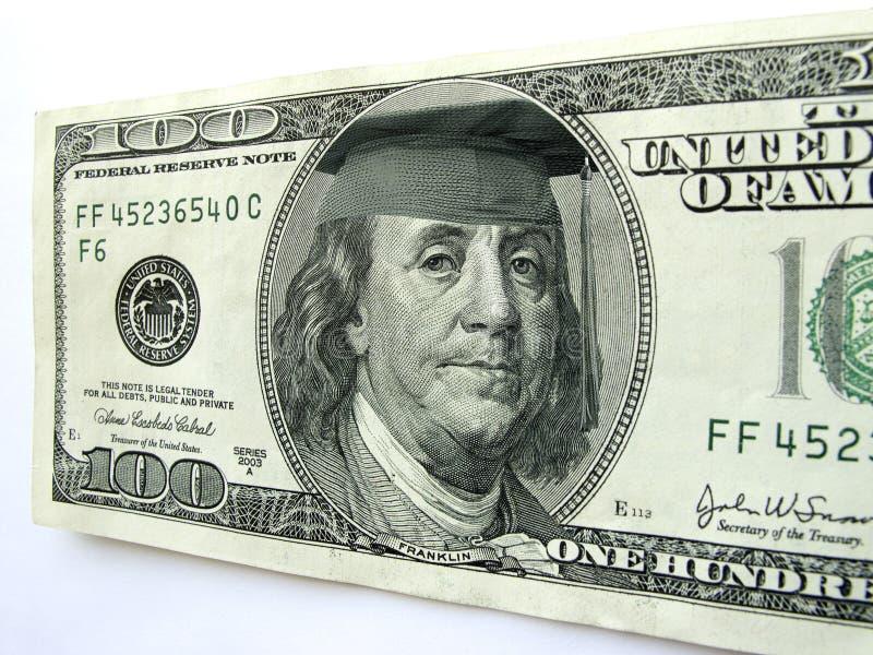 Ben Franklin Wearing Graduation Cap su cento banconote in dollari fotografia stock libera da diritti