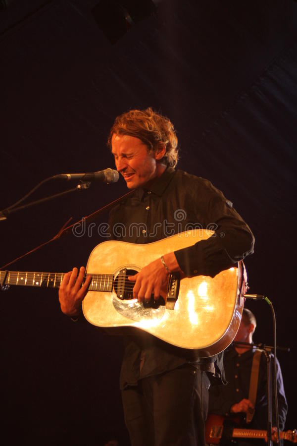 Ben Howard performing at Somersault Festival 2014. Ben Howard performing live on the main stage at first ever Somersault Festival at Castle Hill in North Devon stock image