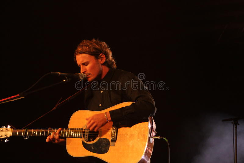 Ben Howard performing at Somersault Festival 2014. Ben Howard performing live on the main stage at first ever Somersault Festival at Castle Hill in North Devon royalty free stock photos