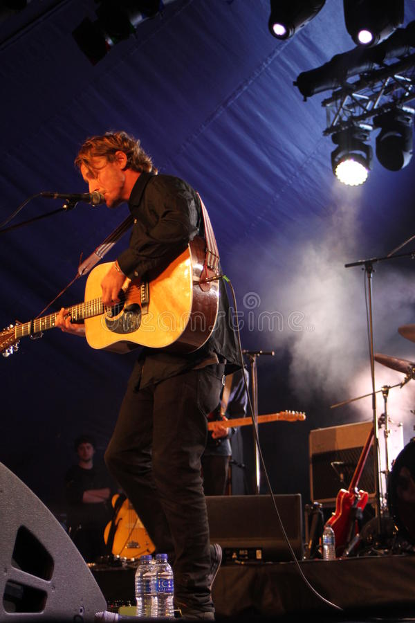Ben Howard performing at Somersault Festival 2014. Ben Howard performing live on the main stage at first ever Somersault Festival at Castle Hill in North Devon stock photo