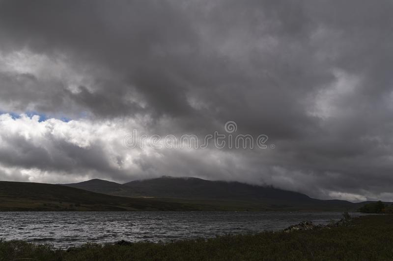 Ben Klibreck. Low cloud and approaching rain covering Ben Klibreck on the shores of Loch Naver in Sutherland, Scotland stock photography