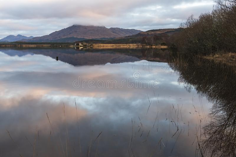 Ben Resipol. Morning reflections of Ben Resipol in Loch Sheil, Argyll and Bute, Scotland stock image