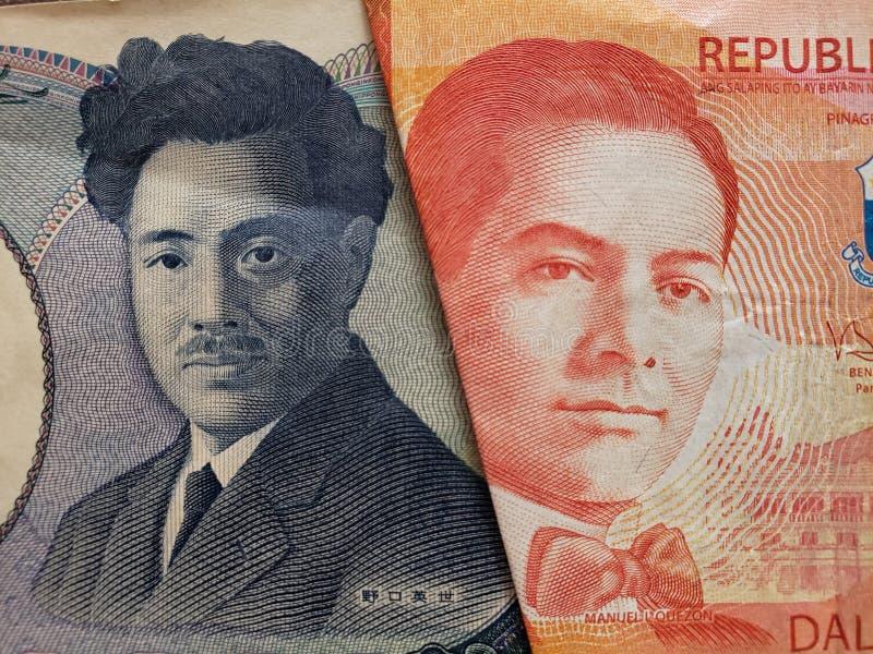 benadering van Japans bankbiljet van 1000 Yen en Filippijns bankbiljet van twintig peso's stock afbeelding