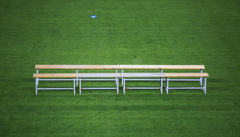 Benc in a soccer stadium royalty free stock photos