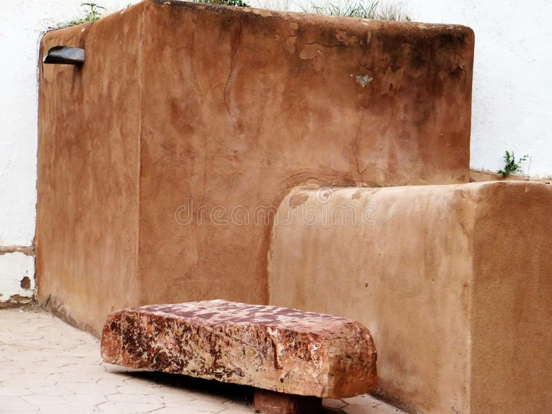 Bench and adobe block, Chimayo stock images