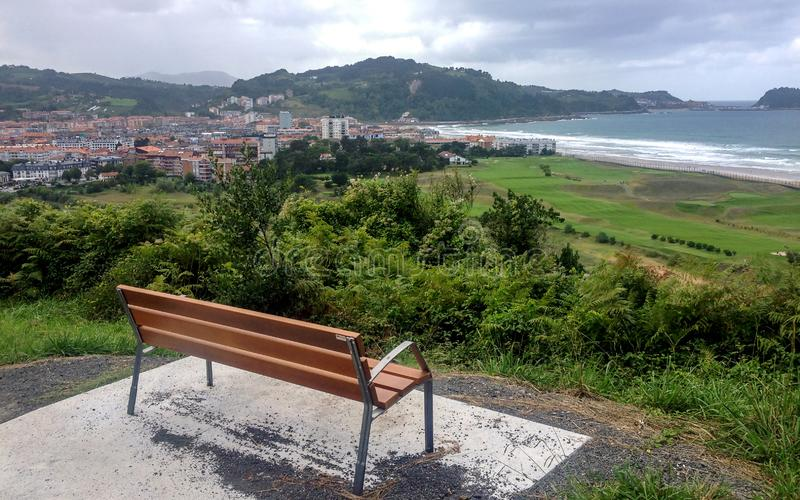 Bench with an amazing view on the beach of Zarautz in Basque Country, Northern coast of Green Spain. Bench with an amazing view on the beach of Zarautz in Pais royalty free stock images