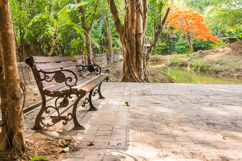 Bench in the autumn park. Vitage style image of bench in the autumn park stock photography
