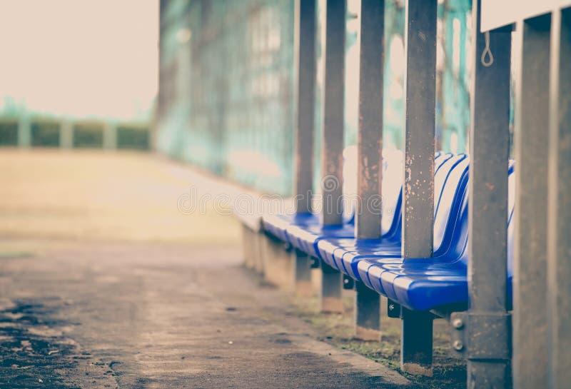 Bench at baseball field stock image