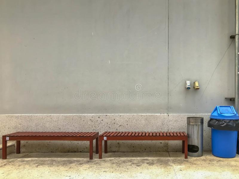 Bench and bin is smoking zone area stock images