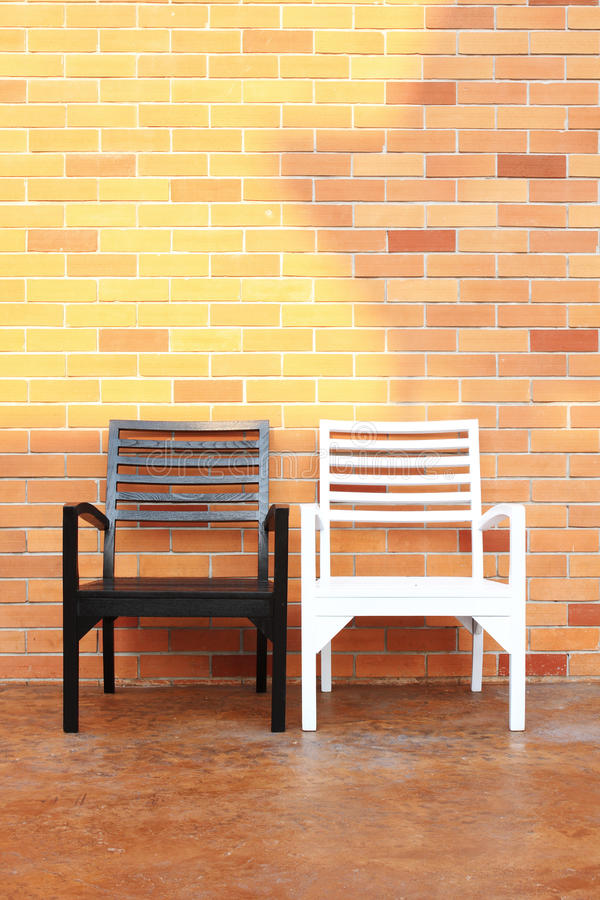 Bench and brick wall royalty free stock photography