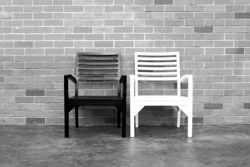 Bench and brick wall stock photos