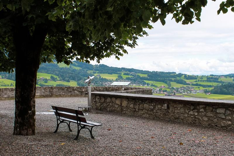 Bench in the castle Gruyere Switzerland. View of the hills. Observation deck stock photos