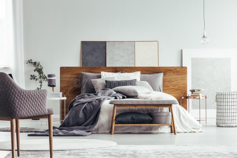 Bench in cozy bedroom interior stock photos