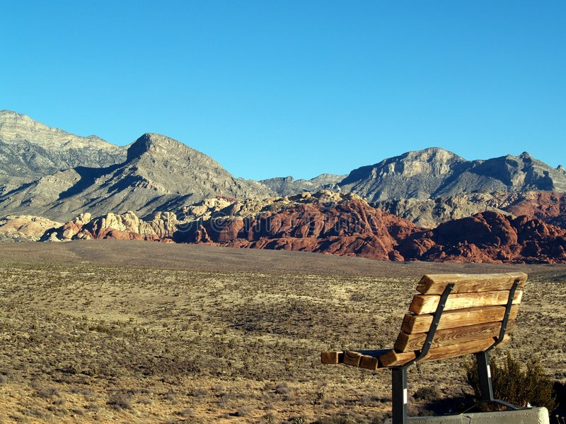 Bench in the desert stock photography