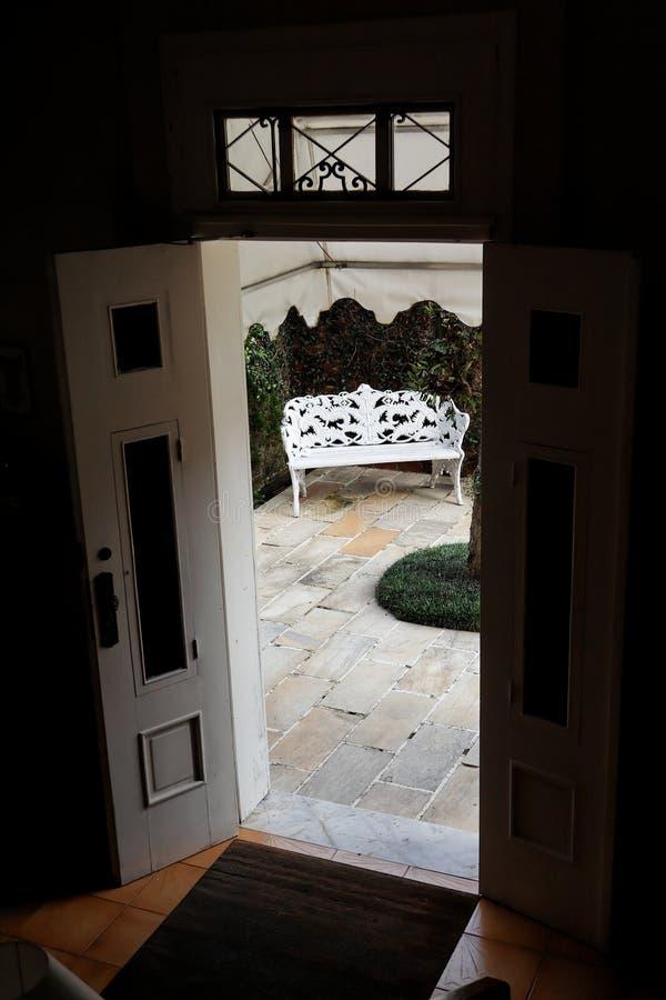 Bench Through a door royalty free stock photography