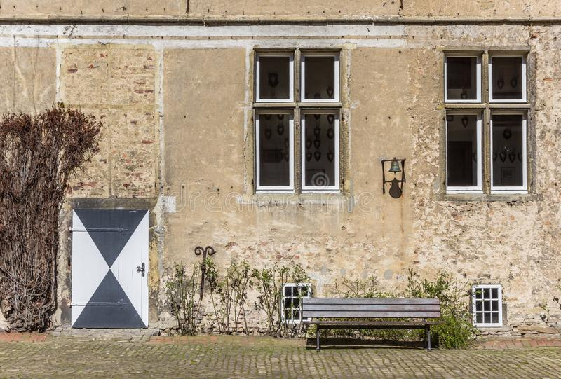 Bench and door at the castle Westerwinkel in Ascheberg. Germany royalty free stock image