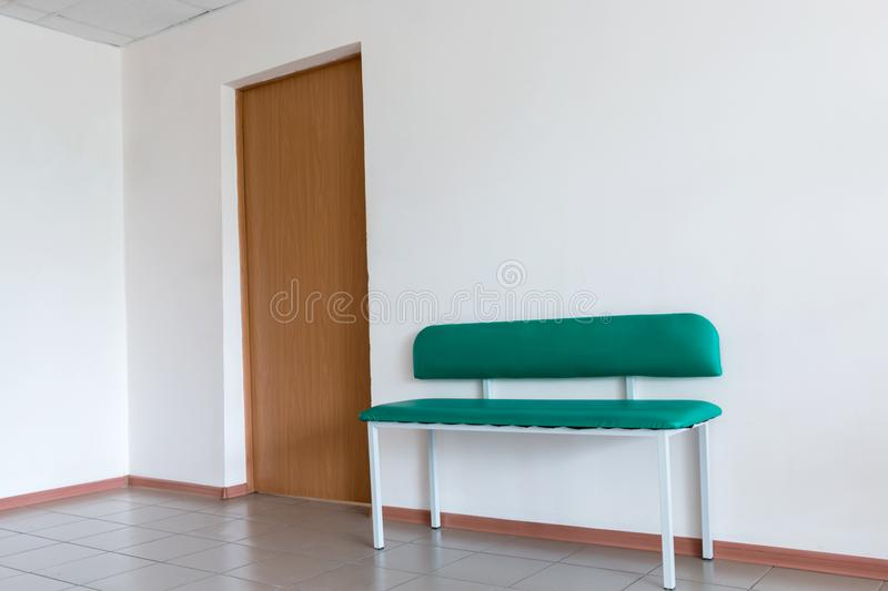 Bench at the door of the office royalty free stock photography